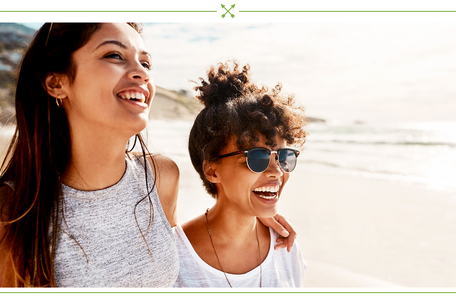 two women smiling at the beach