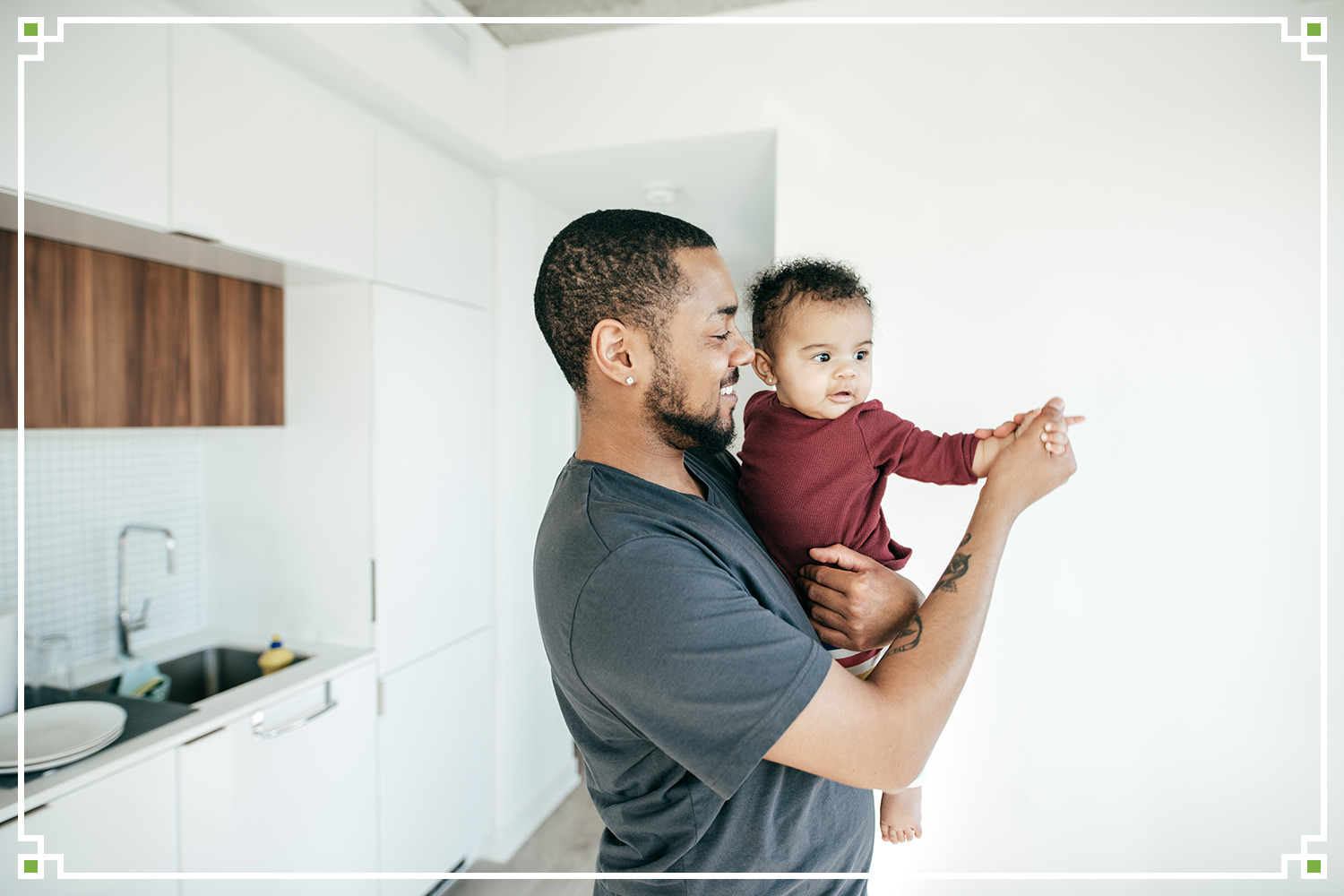father with young infant pointing at something