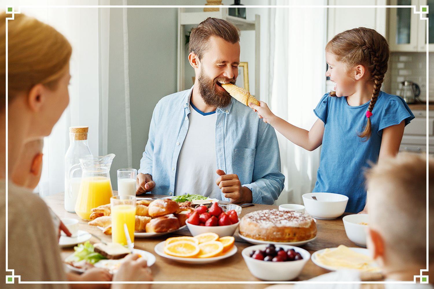 father and daughter joking at breakfast table