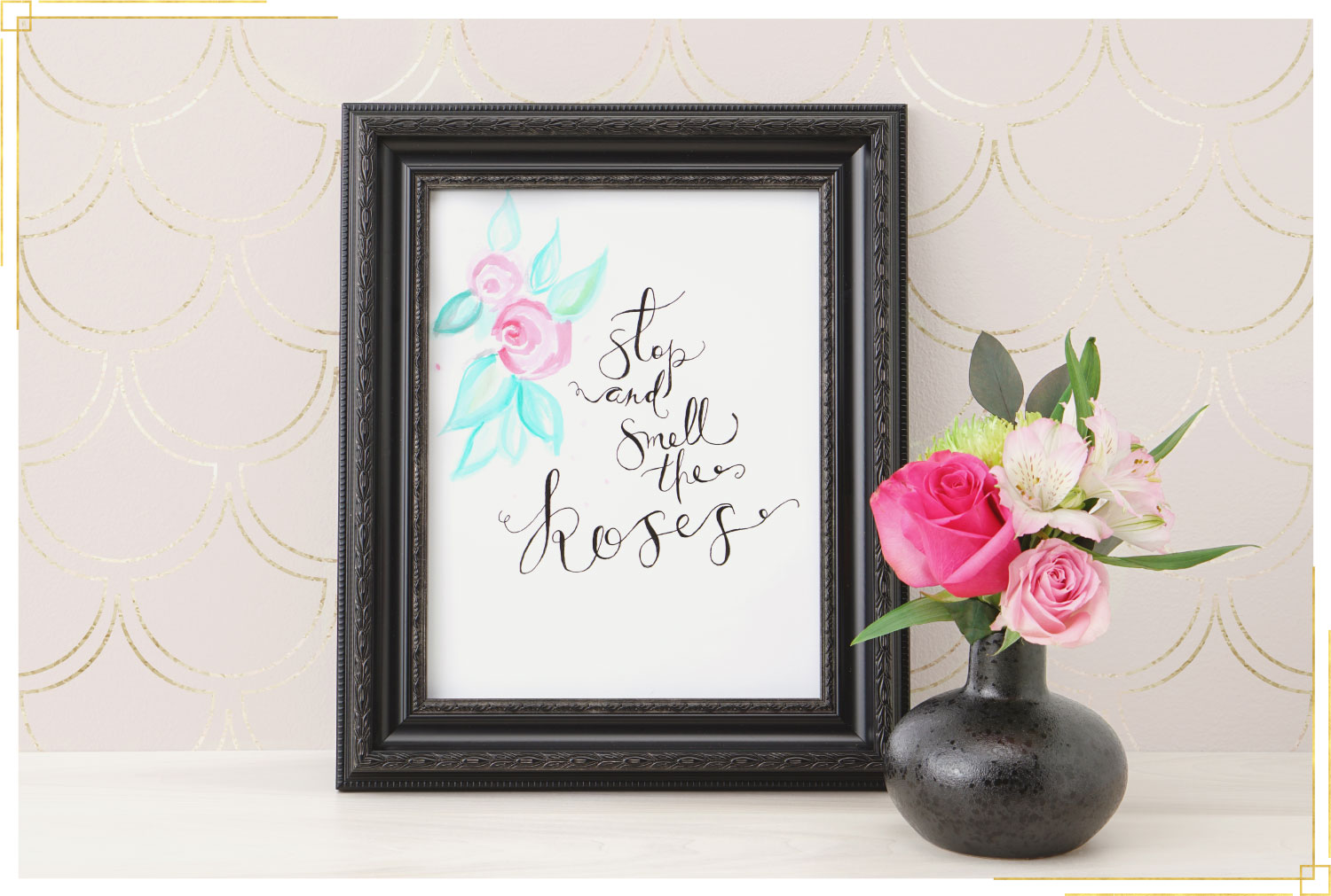 faux calligraphy wall art that says smell the roses with a watercolor flower