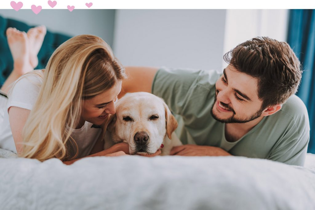 man woman and puppy
