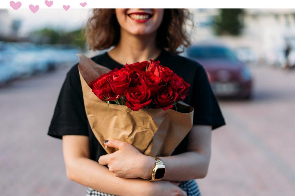 girl smiling holding roses