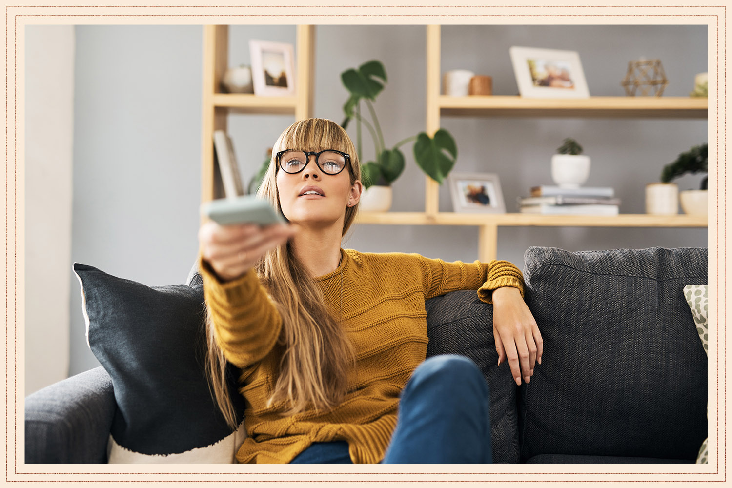 woman with remote for TV