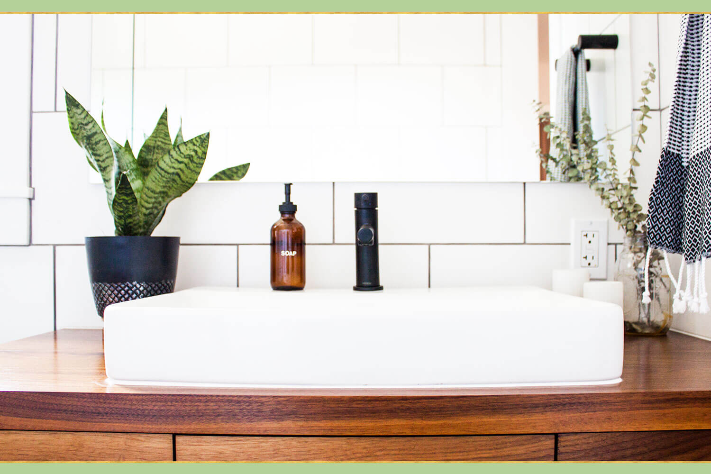 green plant on bathroom sink
