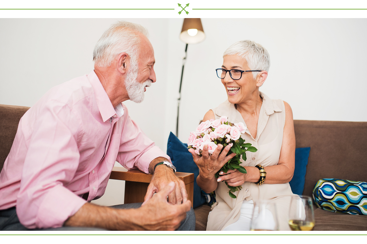 older couple exchanging gifts and flowers