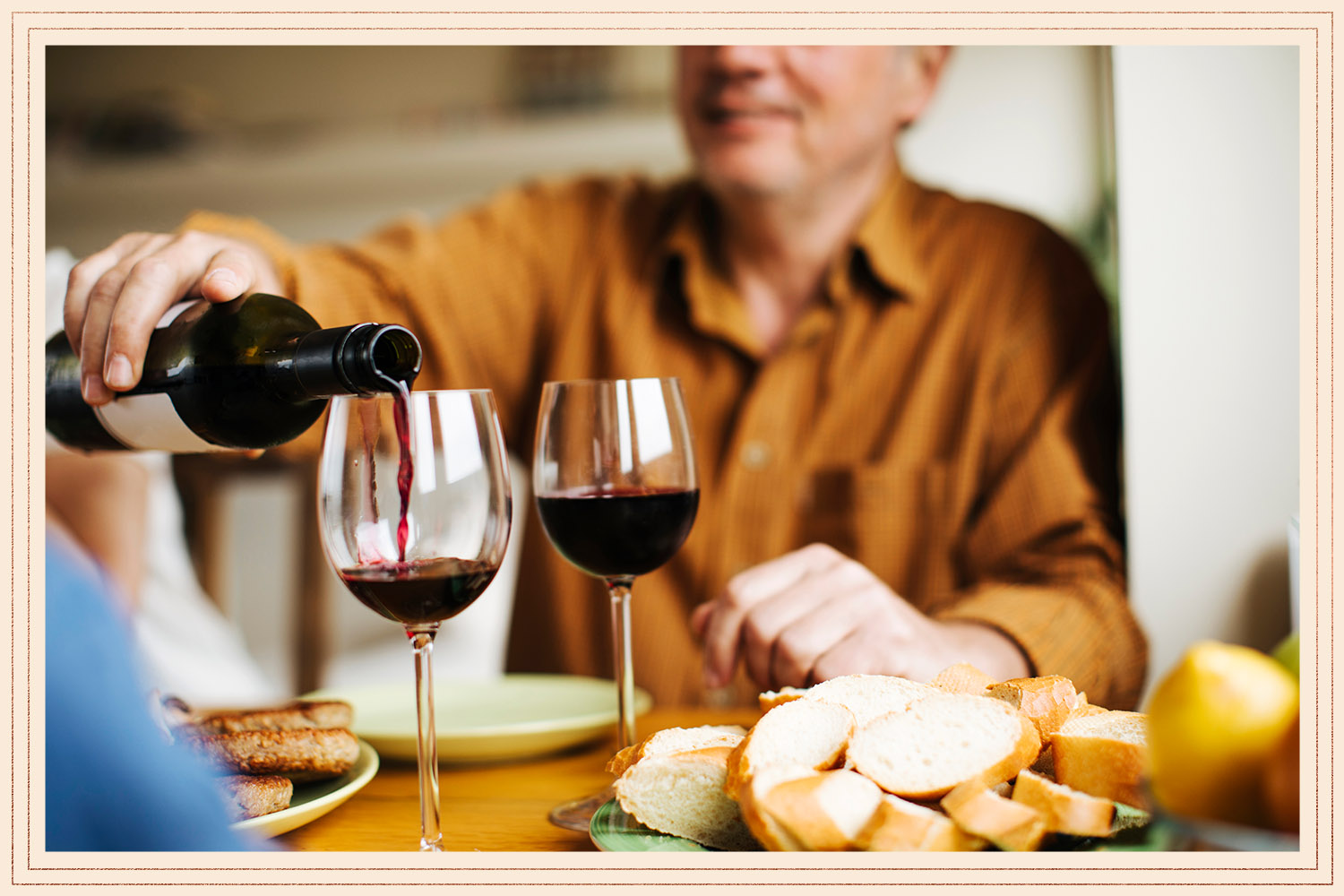 couple having wine with dinner