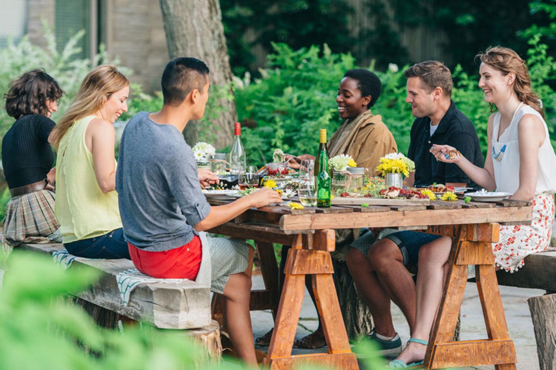 friends enjoying an outdoor picnic