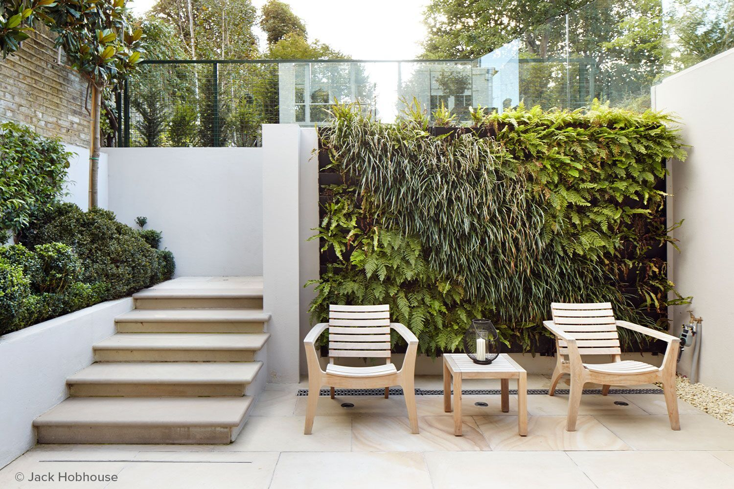 outdoor scene garden wall with patio chairs
