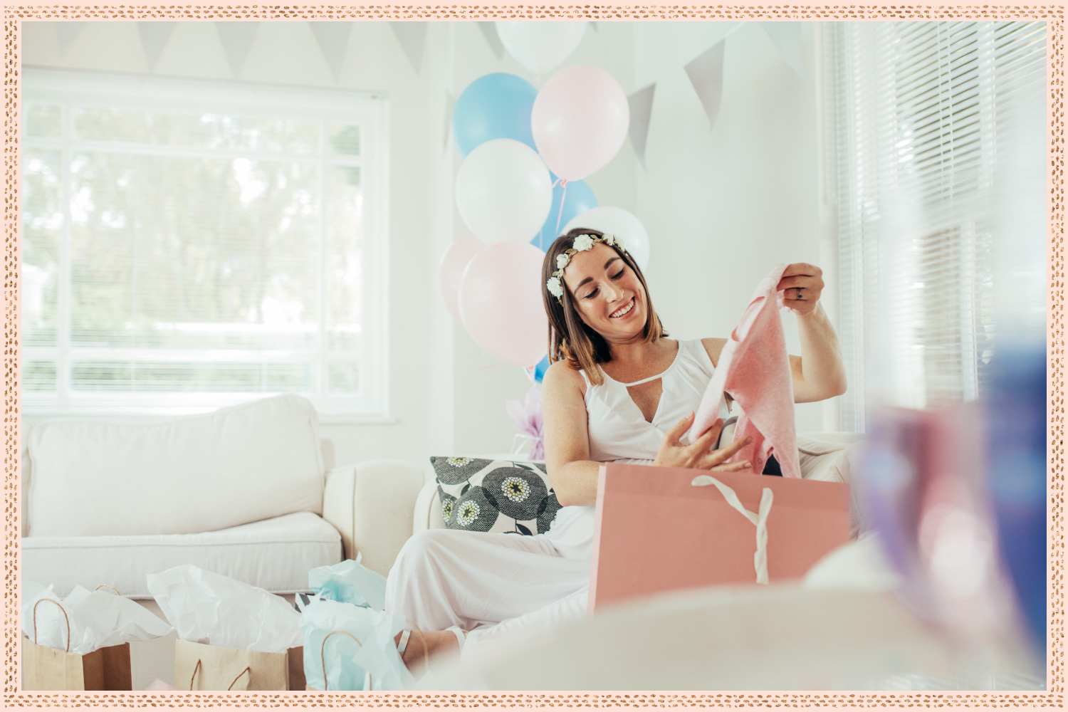 young woman with flowercrown unpacking gifts after baby shower