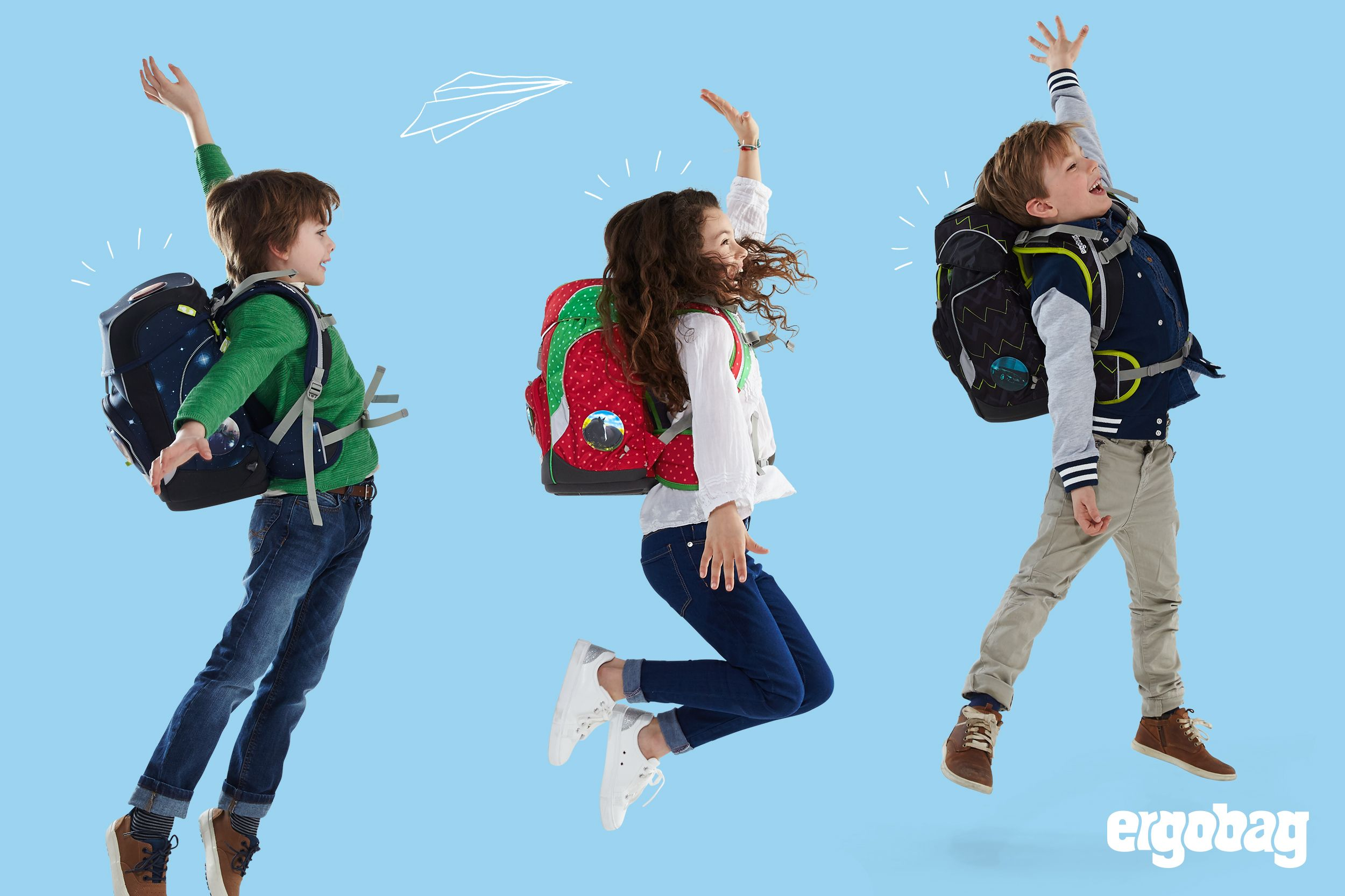 ergobag-three-kids-jumping-school-start