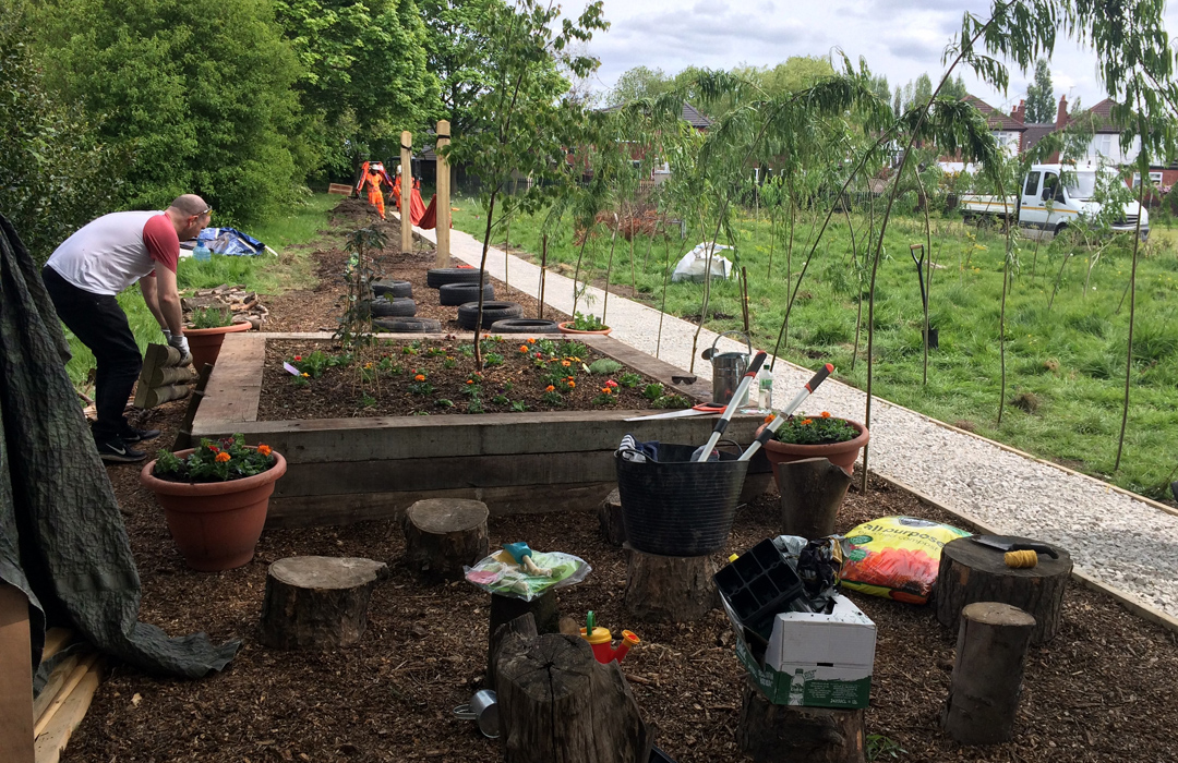 Volunteers transform  Heaton School's  Field
