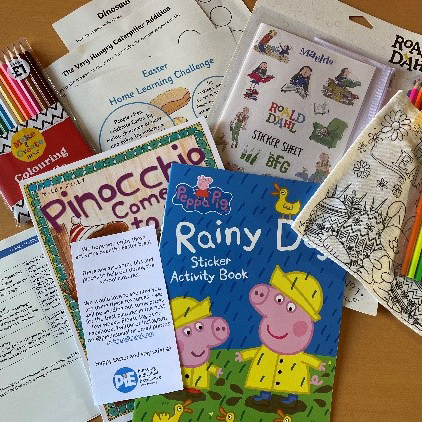 collection of stories, colouring pens and activities