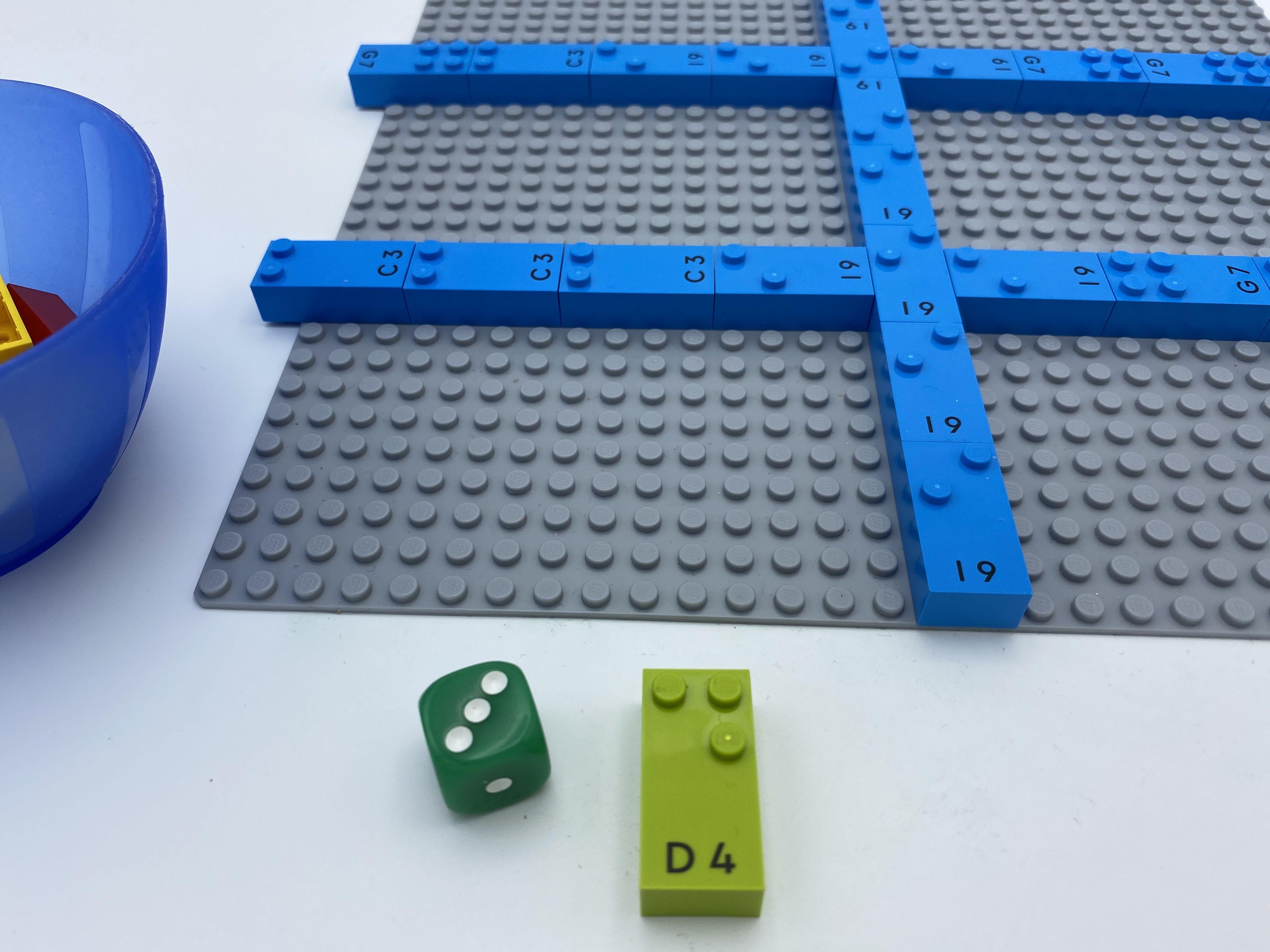 die 1 shows 3, letter brick d.