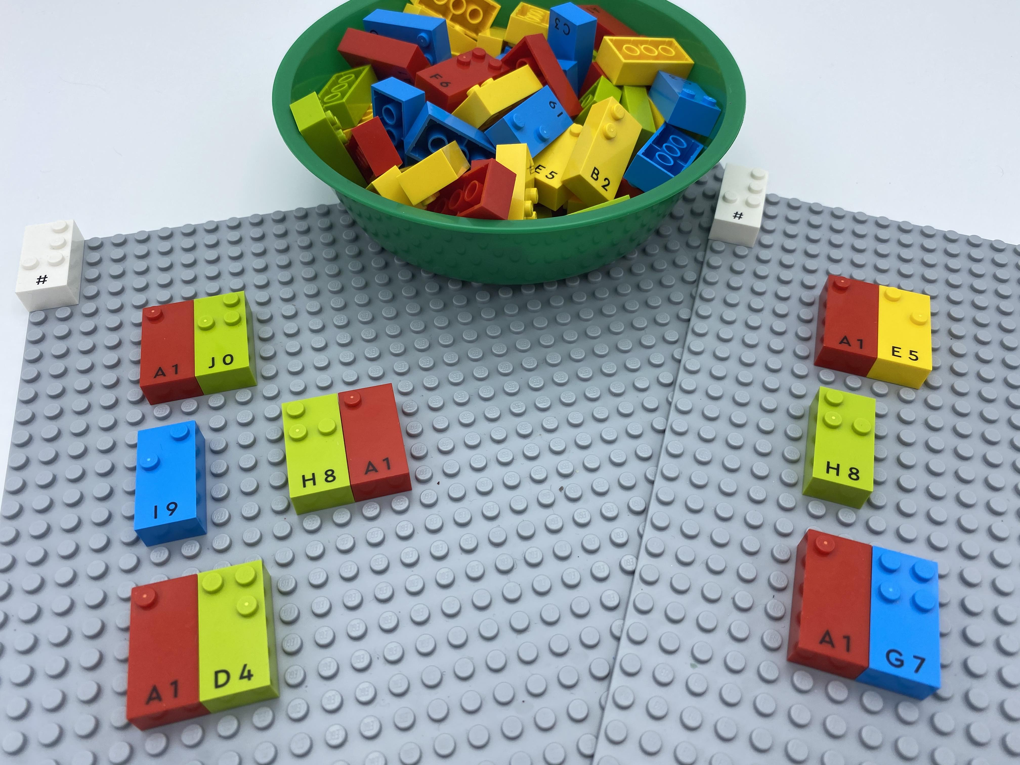 Numbers bricks 8 and 1 placed close to number 9 on Bingo card 1.