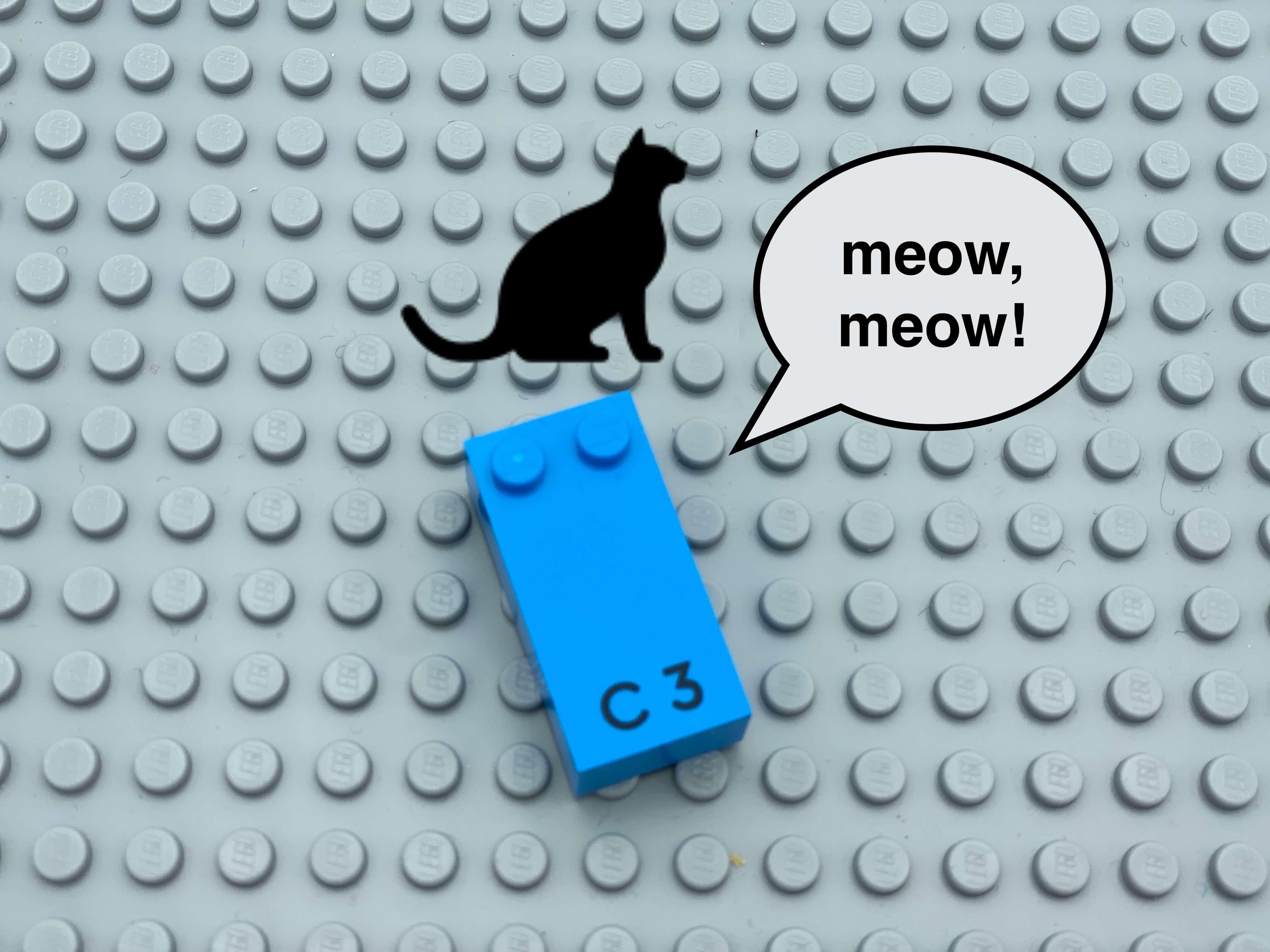 "Letter brick c, speech bubble ""meow, meow"", a picture of a cat."