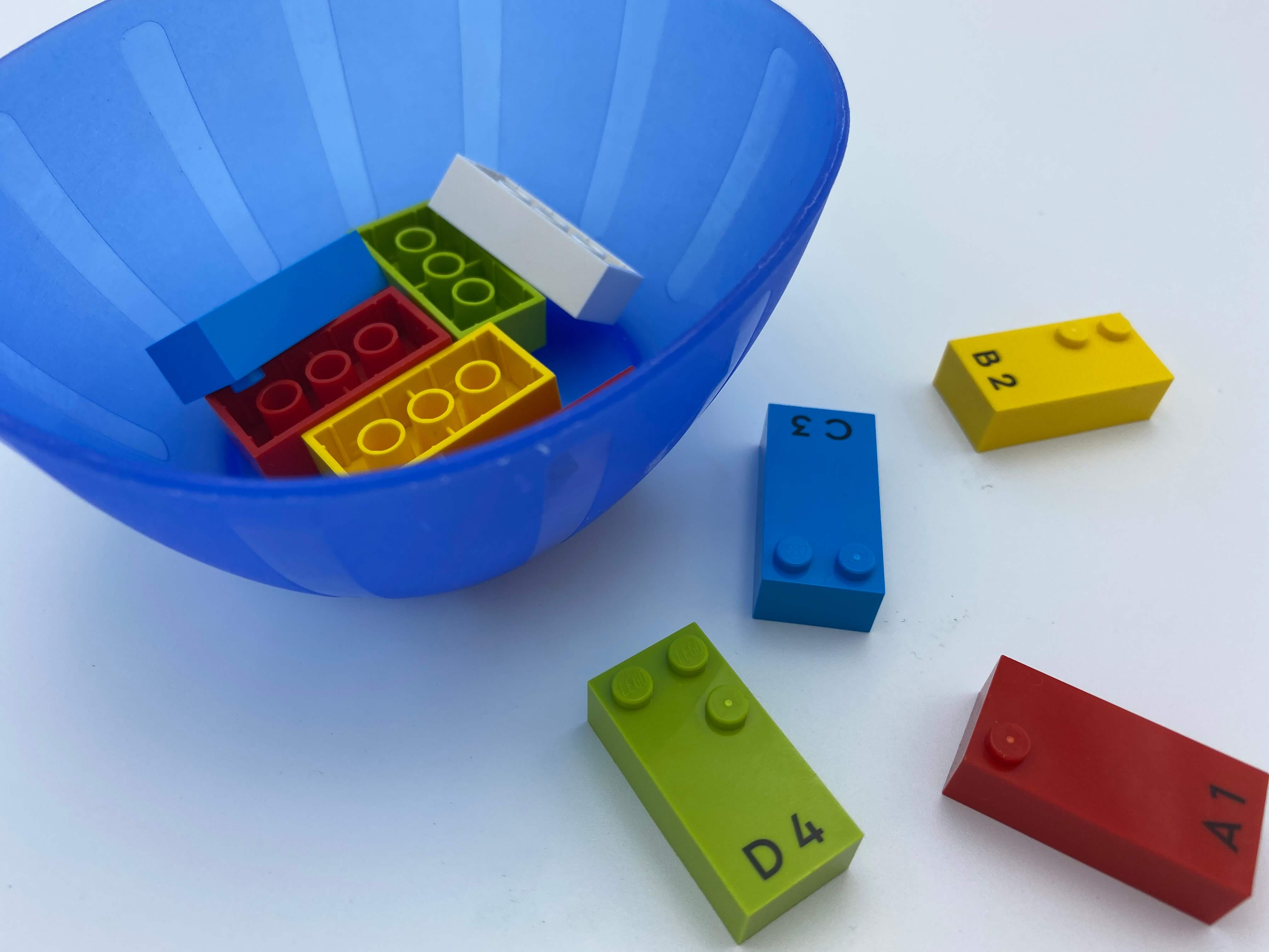 6 bricks upside-down in the bowl, 4 right-side up on the table.