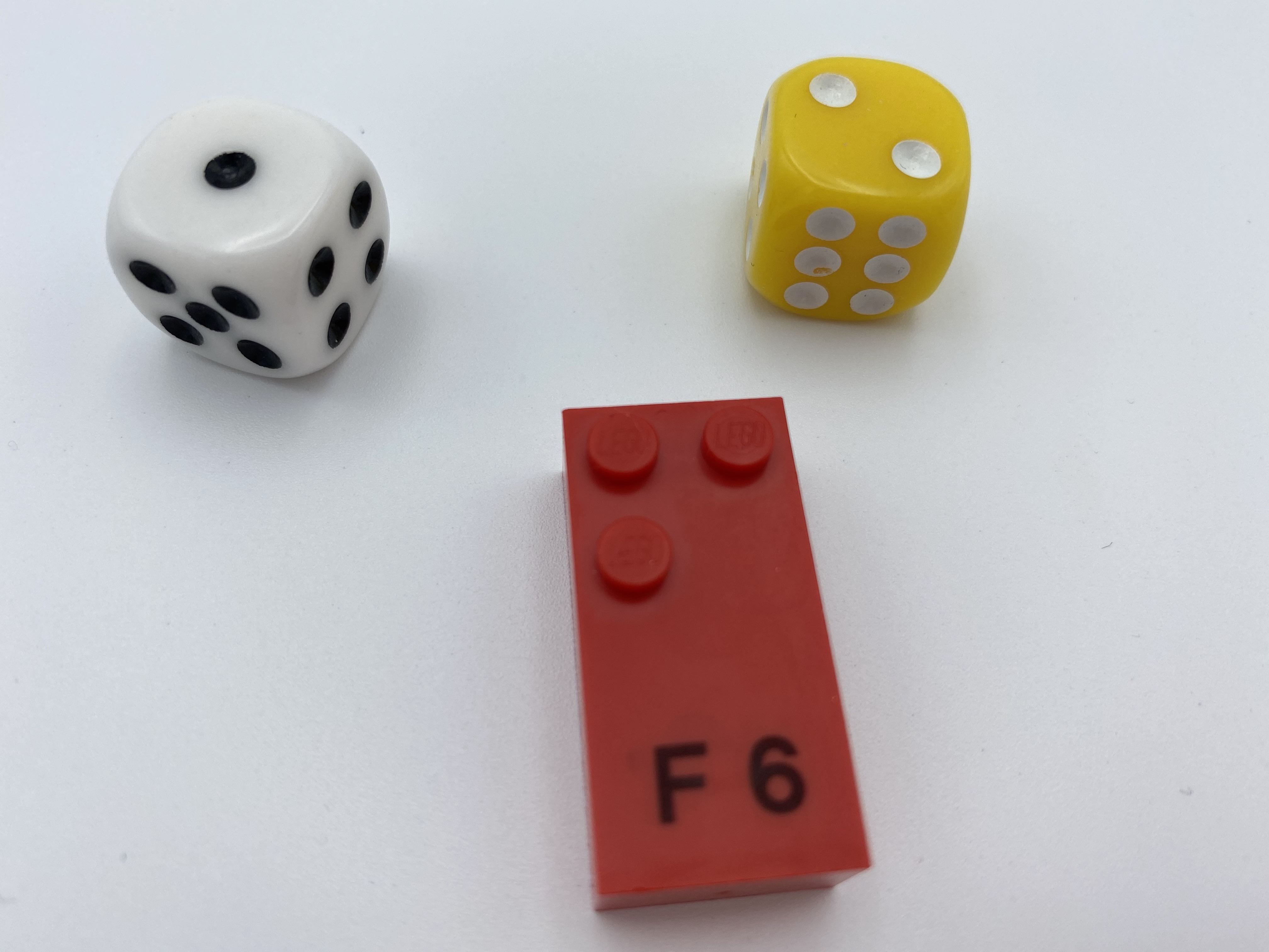 Dice roll: 1 and 2, letter brick F