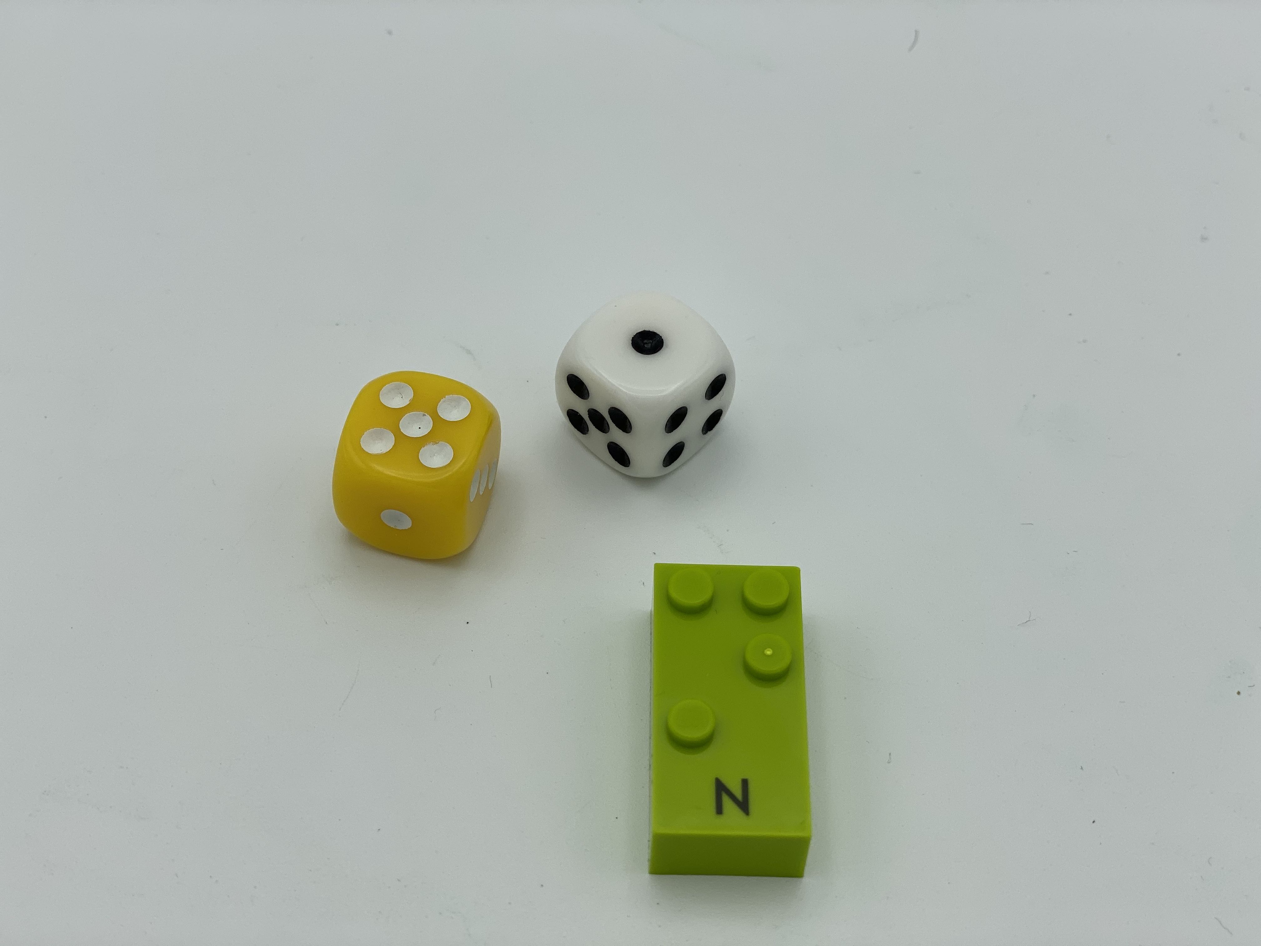 Dice roll: 5 and 1, letter brick N