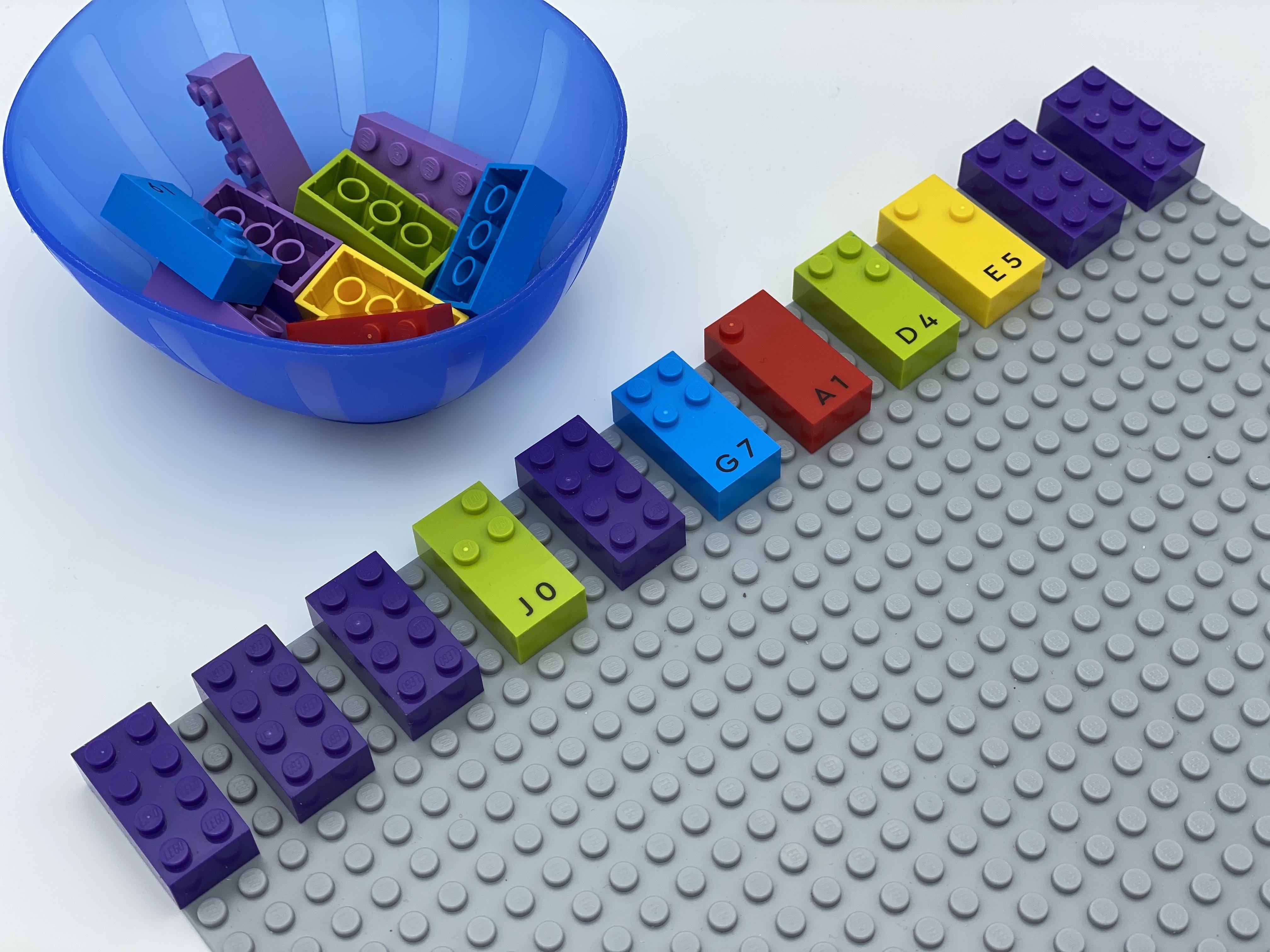 A row of 11 bricks: classic, classic, classic, j, classic, g, a, d, e, classic, classic.