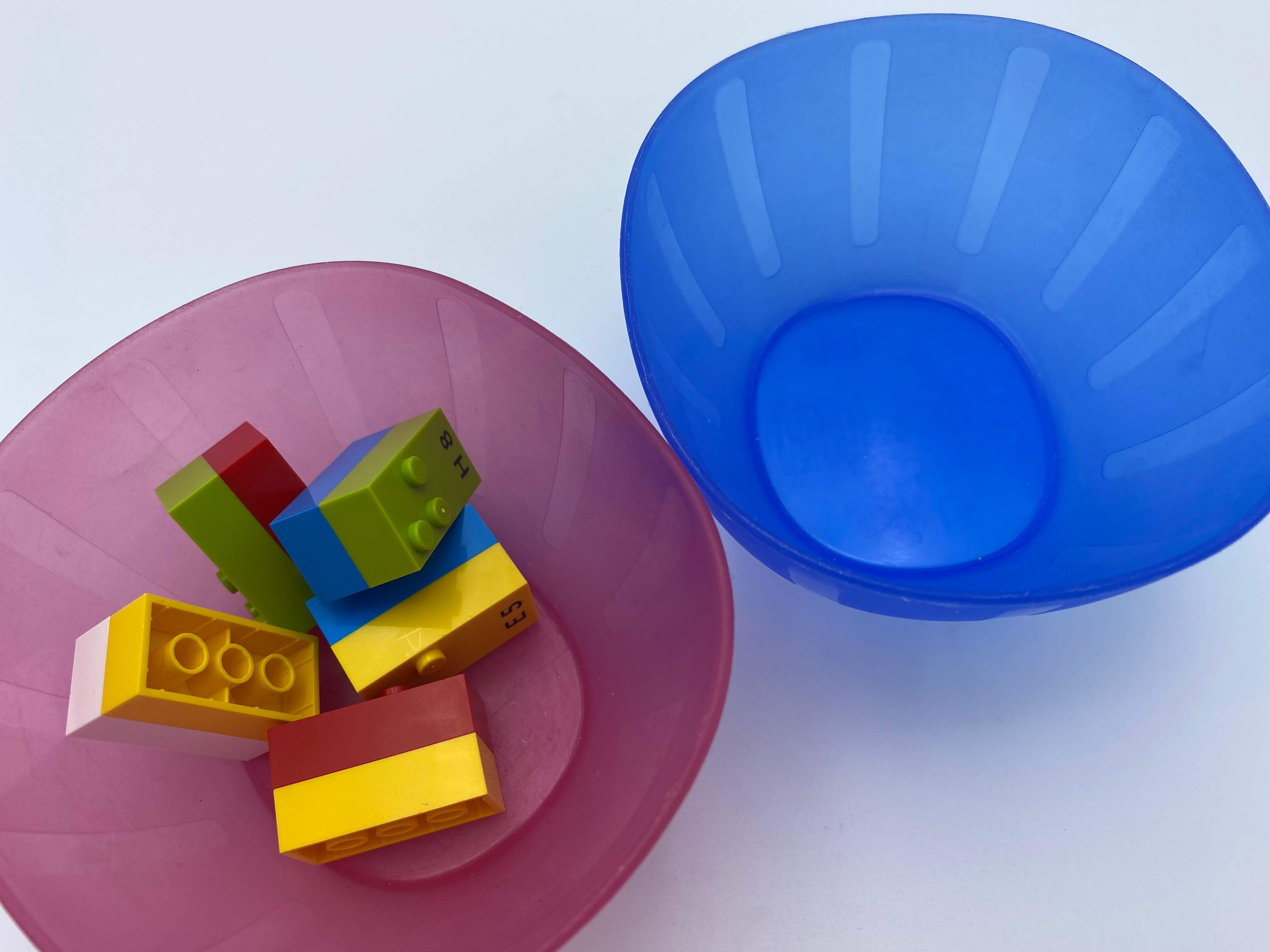 5 pairs of bricks in bowl 1, bowl 2 is empty.