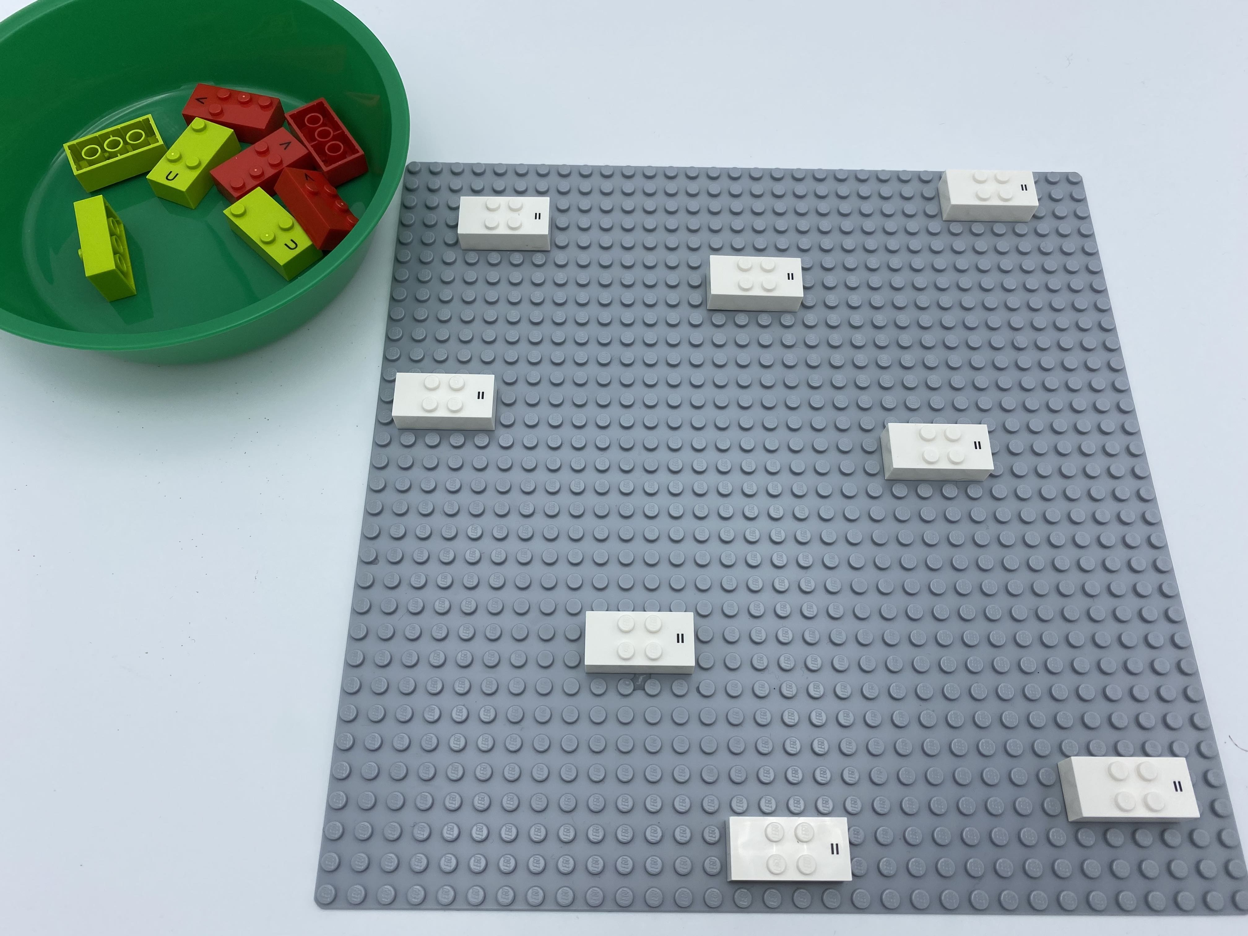 8 equal sign bricks are attached horizontally all over a plate