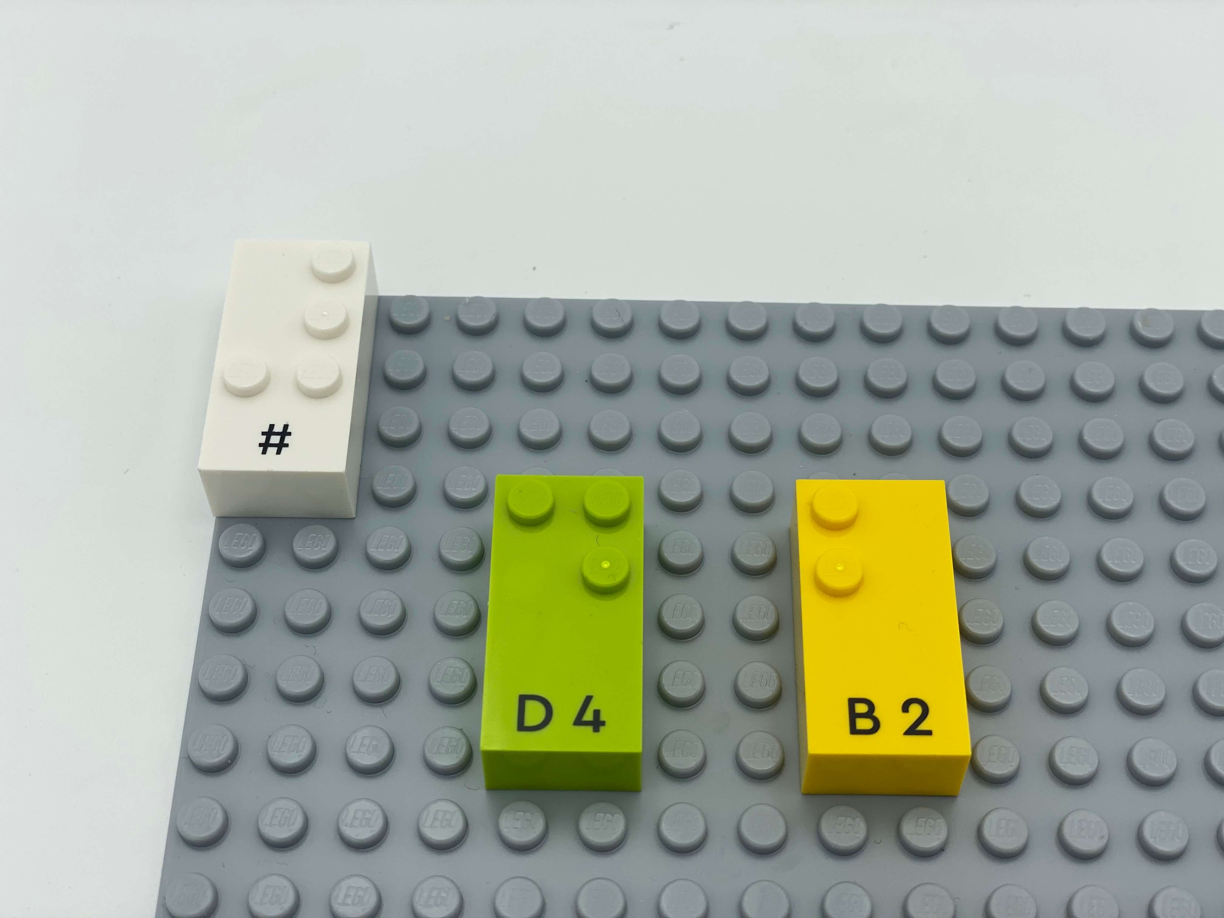 Number brick sign, number bricks 4 and 2 on the base plate.
