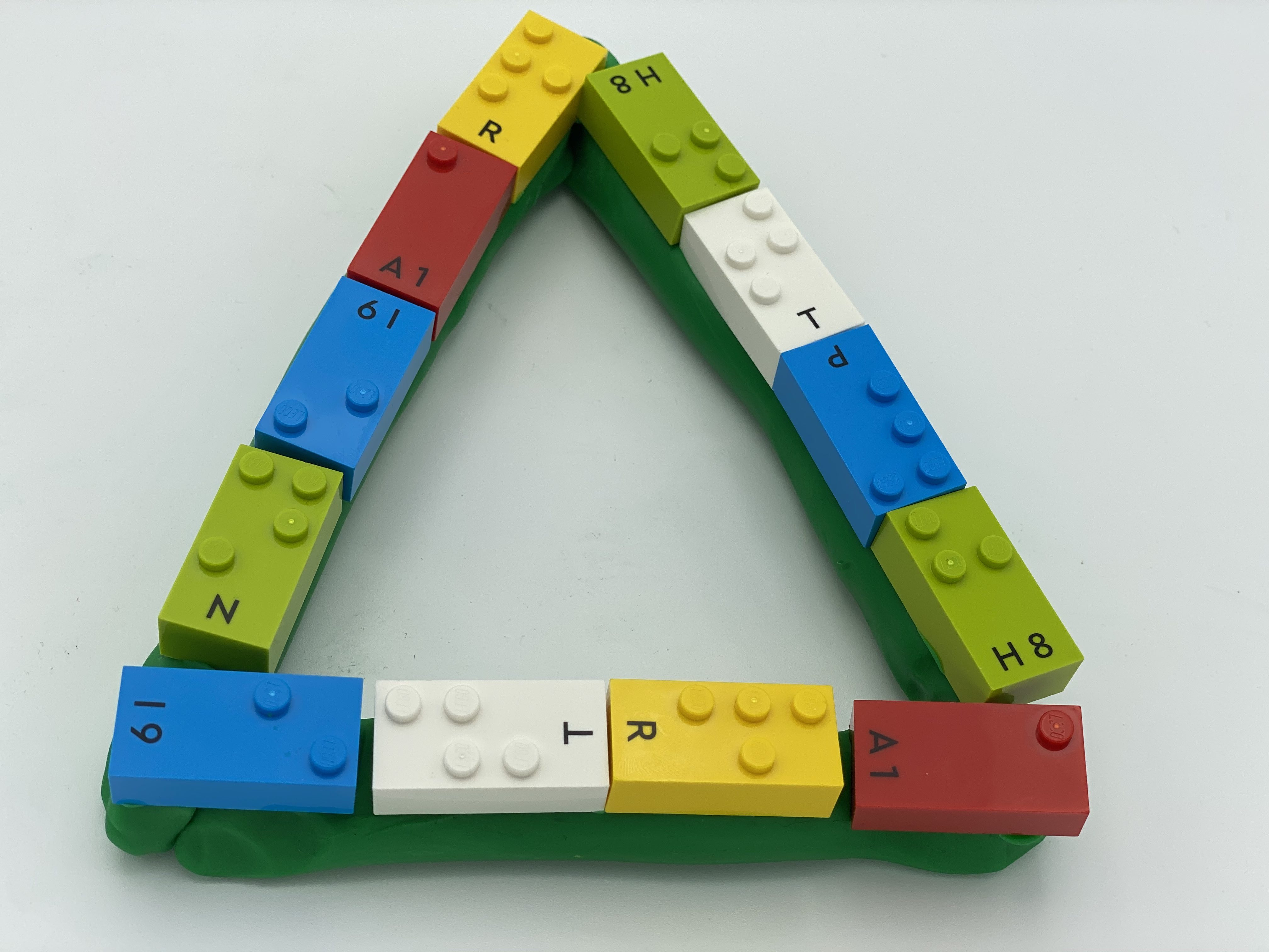 A triangle shape of Playdough with 12 LBB on it.