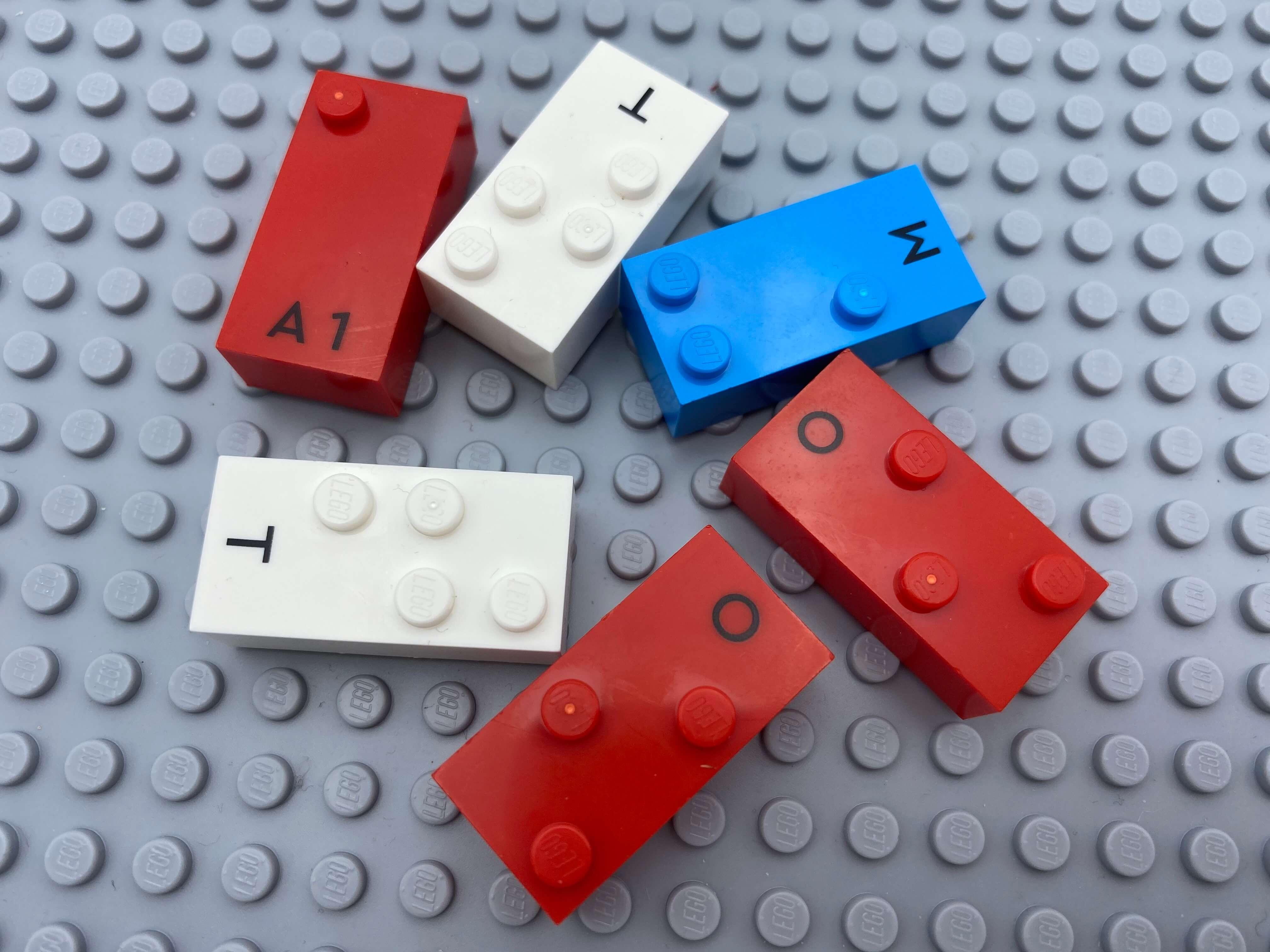Letter bricks a, t, t, m, o, o.