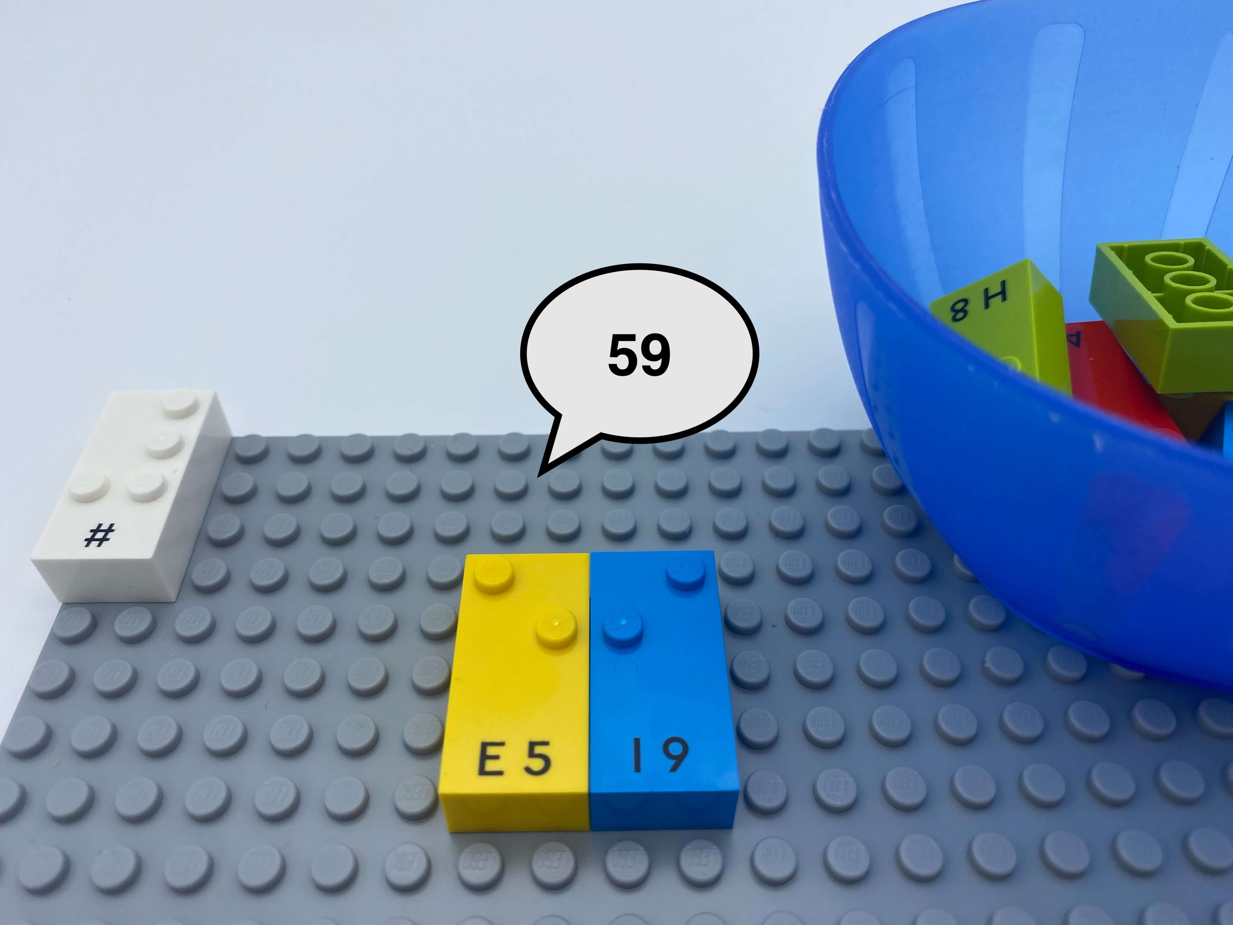 Number sign brick, 2 number bricks 5 and 9 on the base plate, a speech bubble says 59, a bowl with bricks.