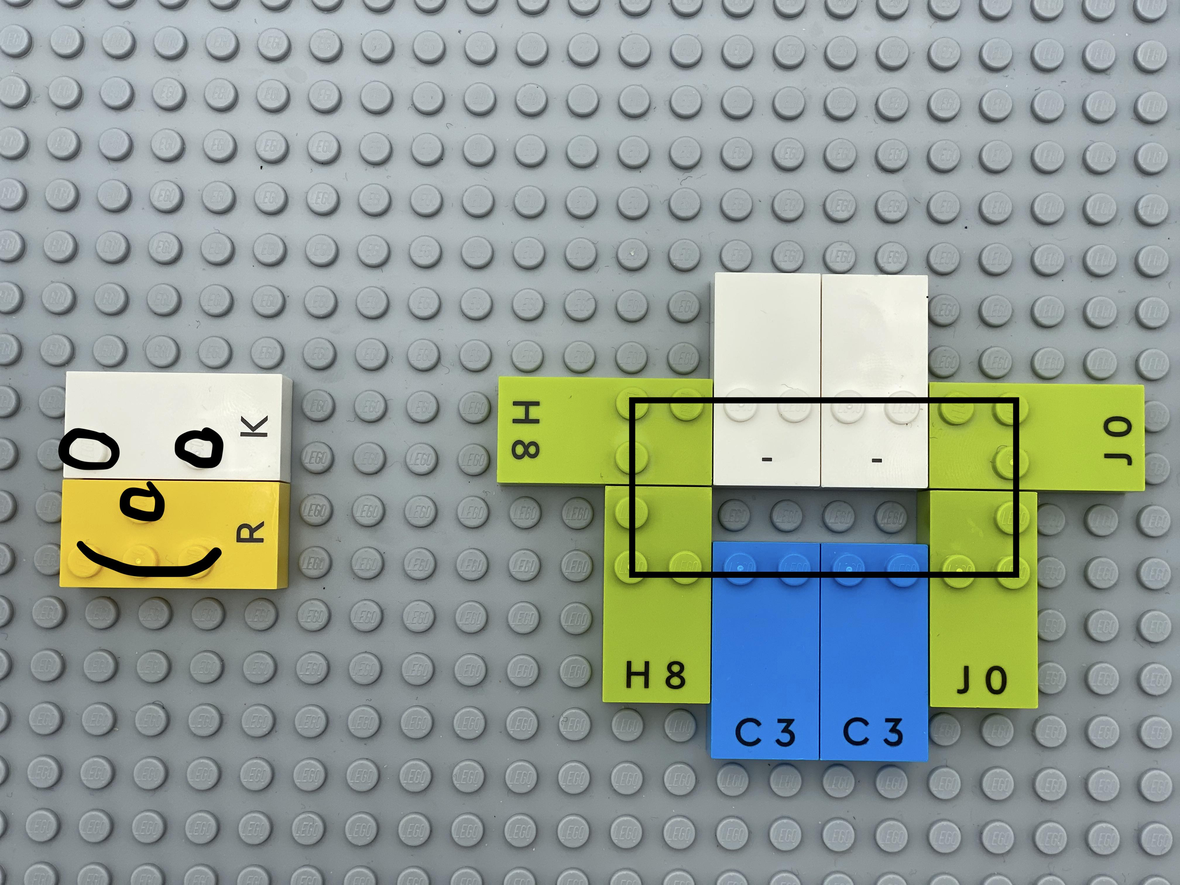 A smiley is made with dots (bricks k and r), a rectangle (h, 2 - , 2  j, 2 c).