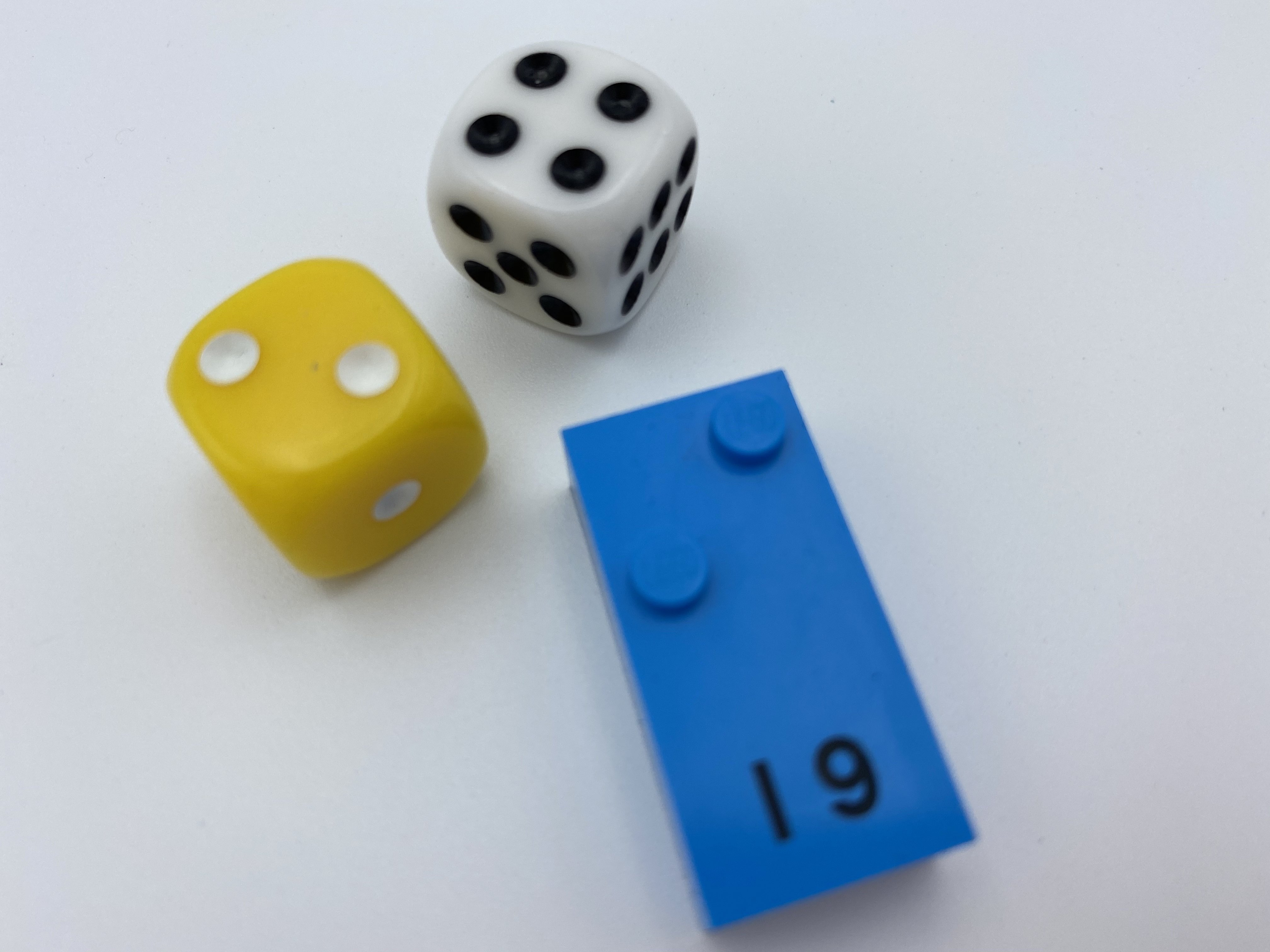 Dice rolls: 2 and 4, letter brick i.