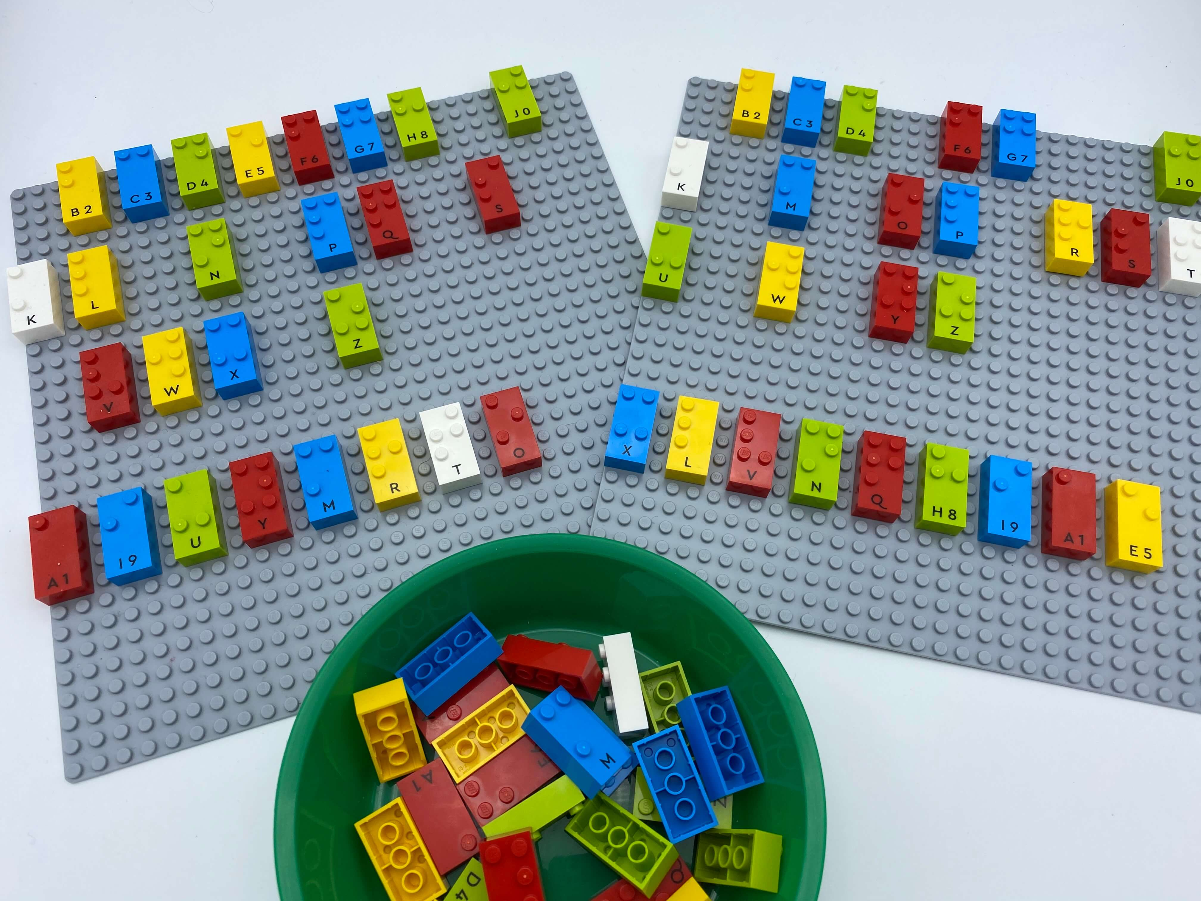 """2 """"alphabet"""" base plates where letters have being removed. First plate, letter bricks a, i, u, y, m, r, t, o, second x, l, v, n, q, h, i, a, e."""