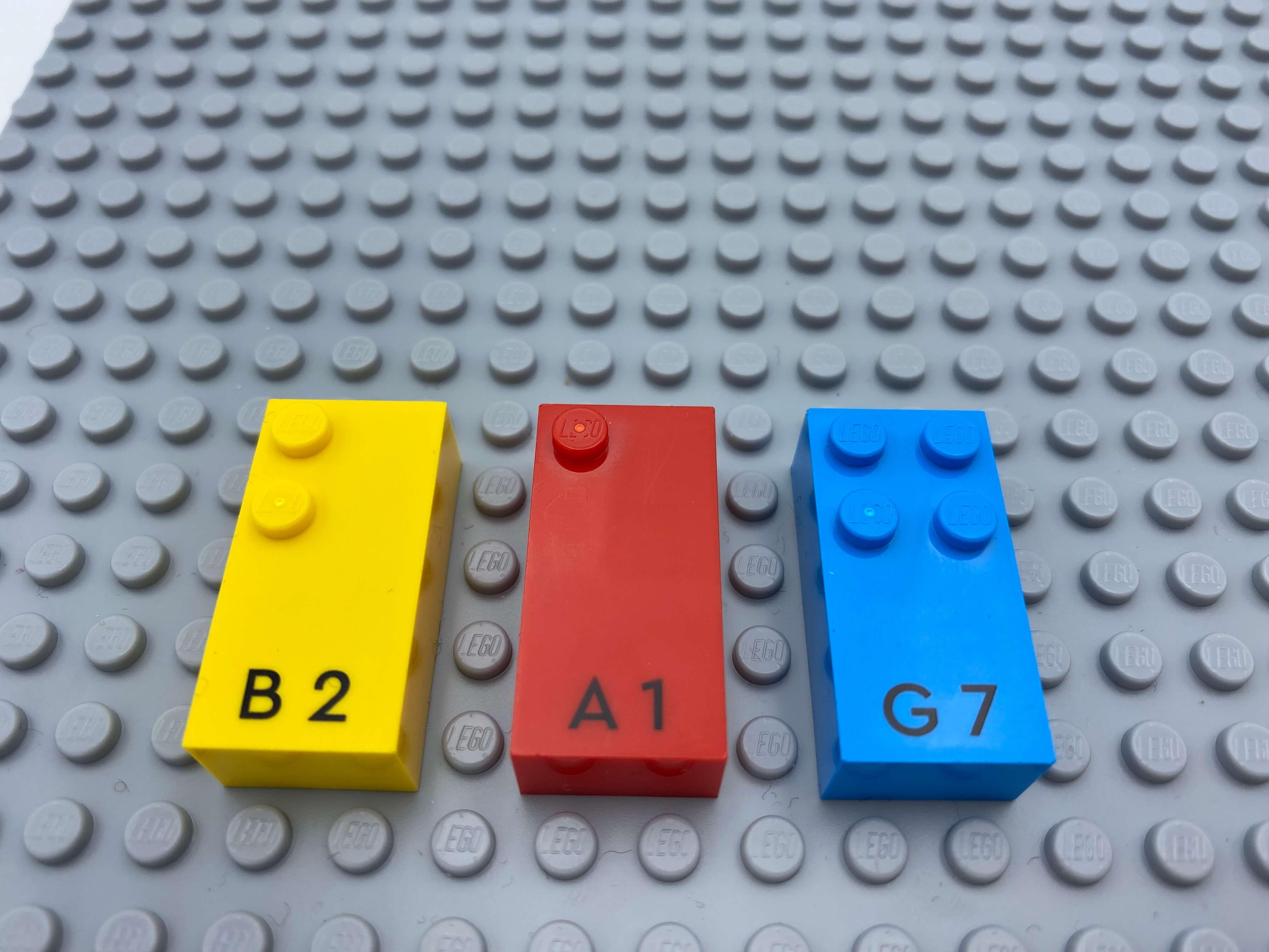 Letter bricks b, a, g aligned on the base plate.
