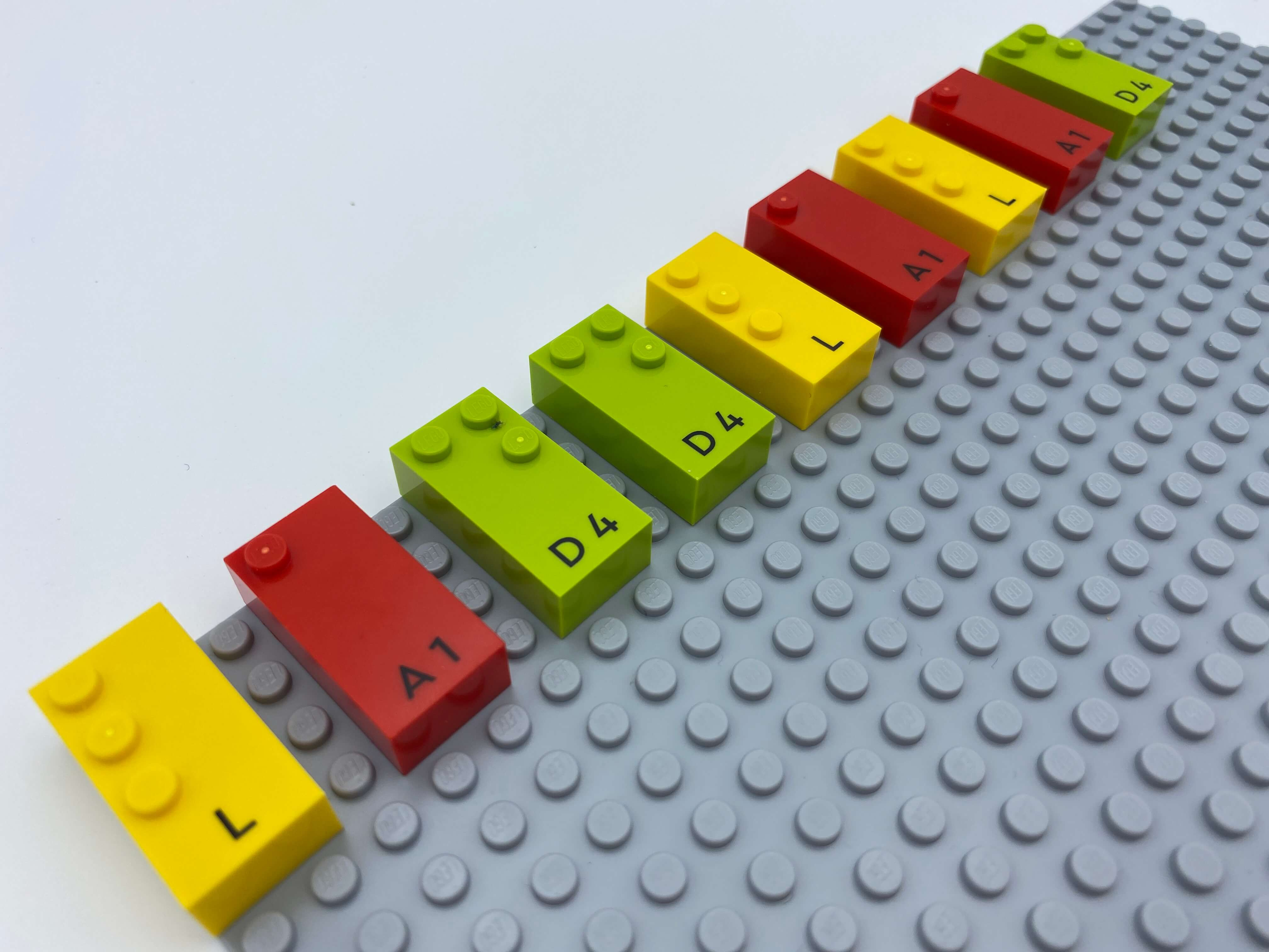 3 towers of identical letter bricks: l, a, d.