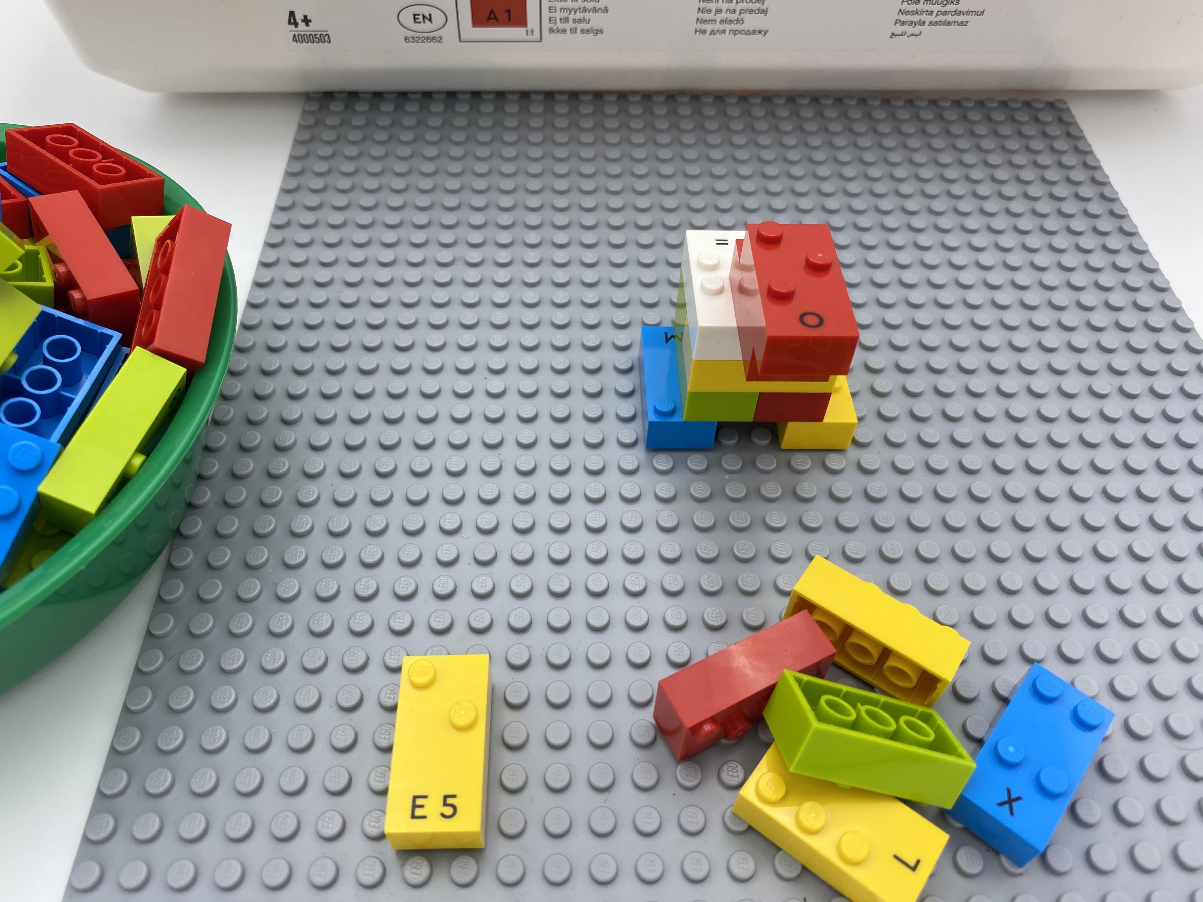 A bull made of 10 bricks, number brick 5, 5 random bricks on the base plate.