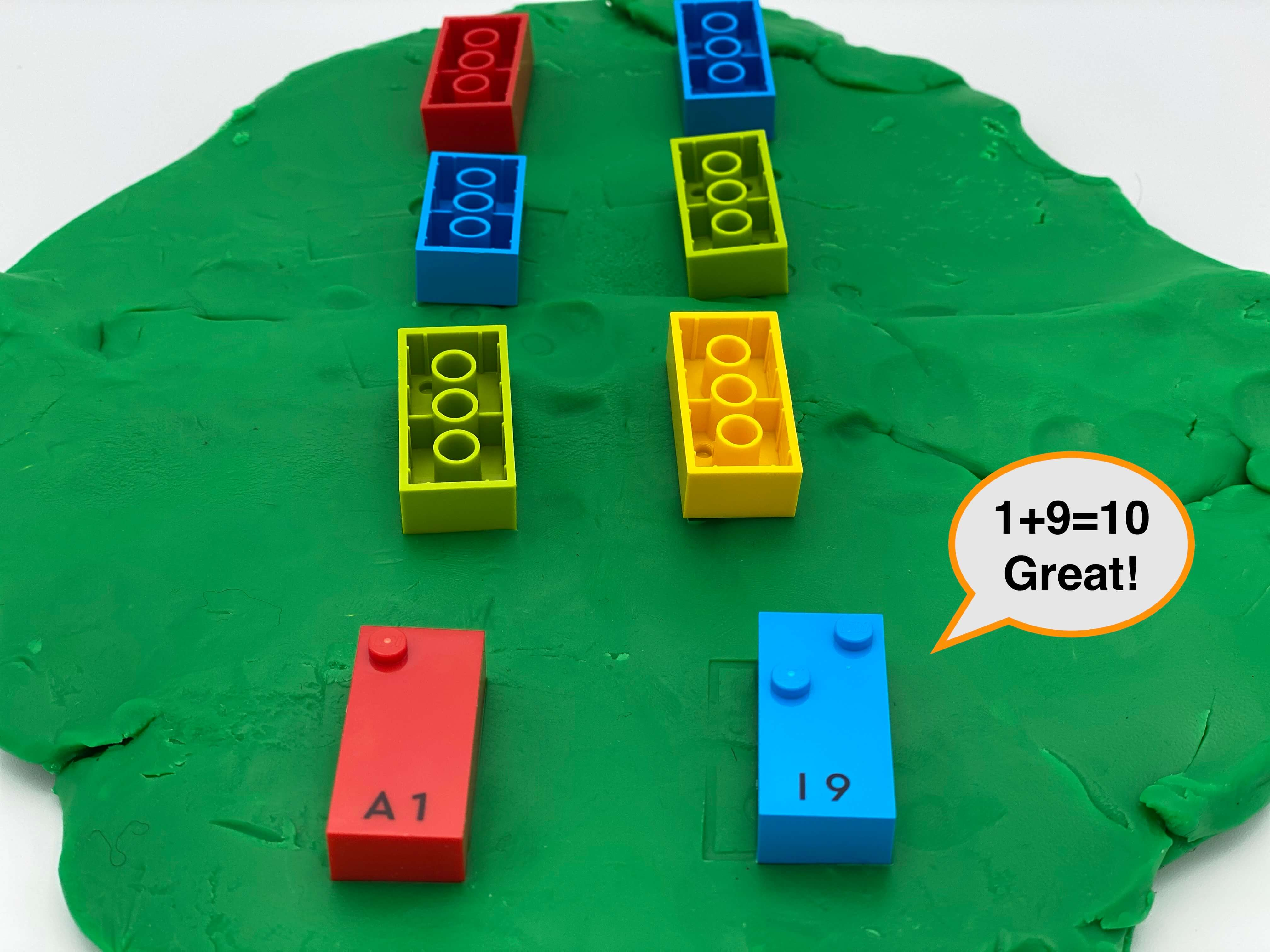 A disc of play dough with 8 bricks: 6 upside-down, 2 right-side up showing number 1 and 9.A speech bubble says 1+9=10 Great!.