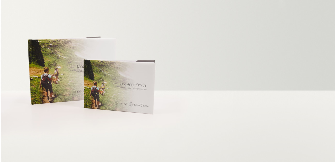 Two books of remembrance in two sizes printed with photographs and text
