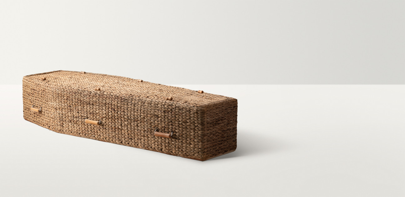 Woven banana leaf coffin with small wooden fastenings