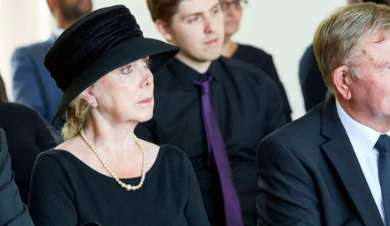 Lady at a traditional funeral dressed in black.