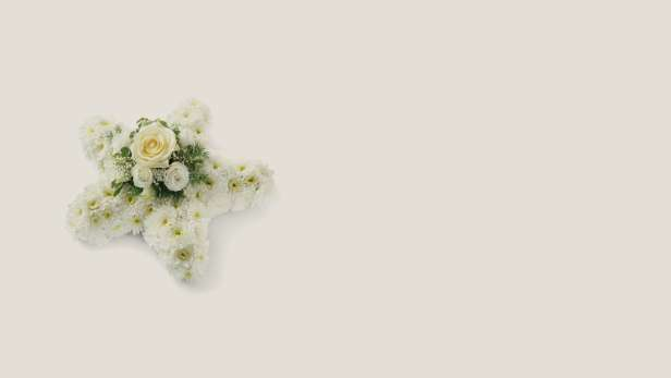 Cross shaped floral arrangement with white flowers