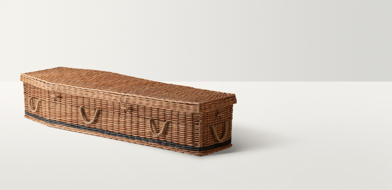 Full length image of the willow coffin in a natural colour with a thin dark stripe at the base
