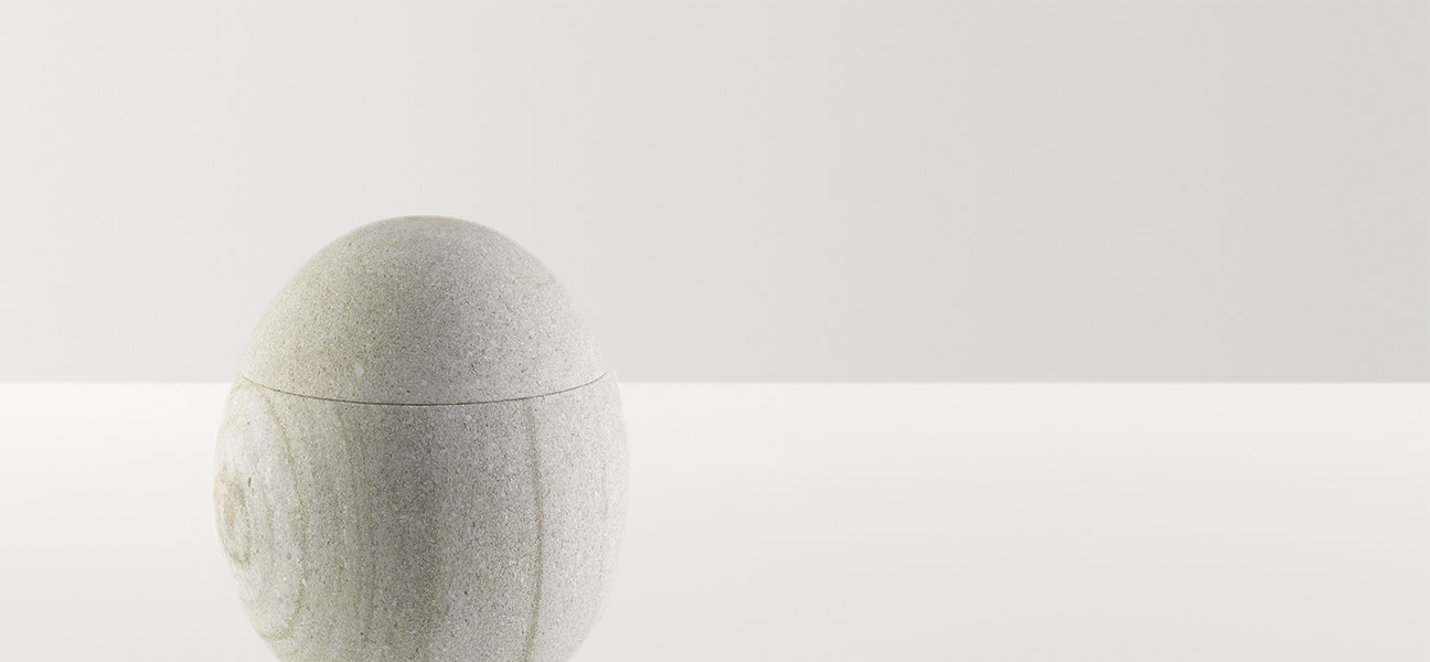 White stone egg on a stand