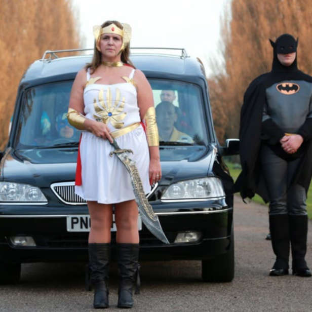 Hearse procession with attendants in superhero costumes