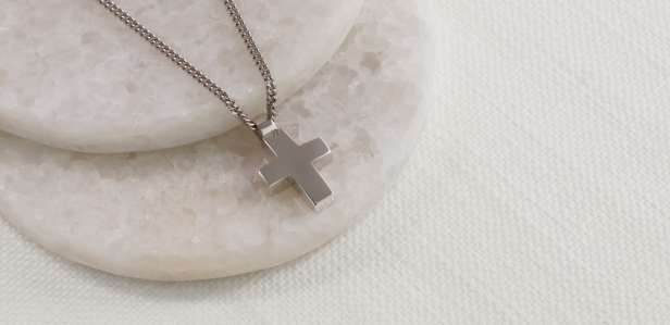White gold cross pendant on a chain
