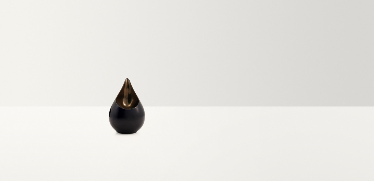 Black and gold teardrop shaped ornament