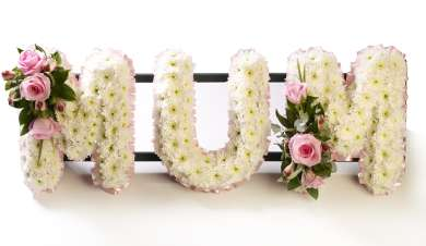 floral mum tribute in white and pink flowers.