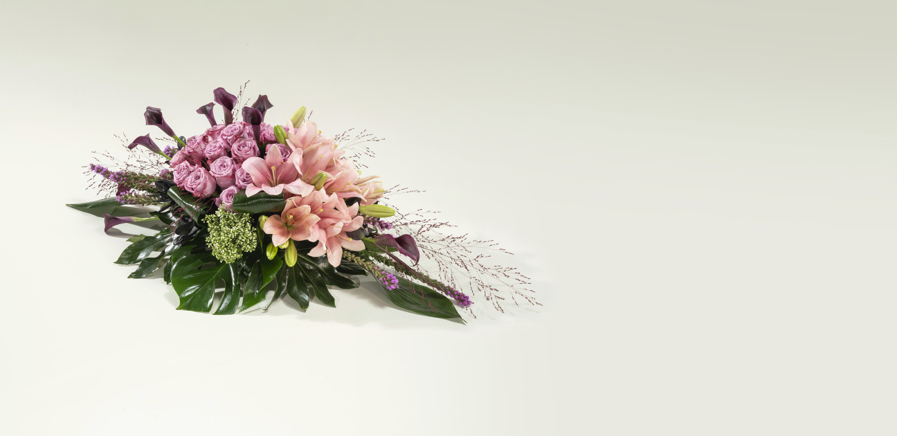 Brightly coloured spray floral arrangement