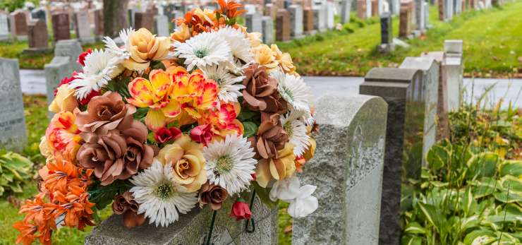 Autumnal flowers on a gravestone