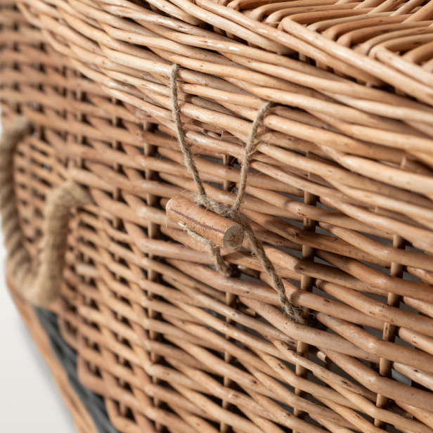 Close up of wicker coffin with cord handles and toggle fastening