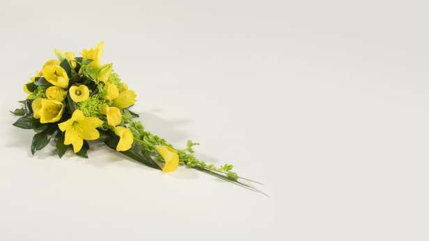 Spray floral arrangement with bright yellow flowers